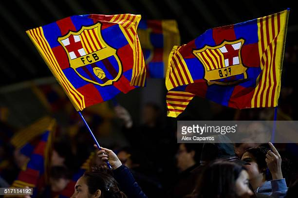 Supporters of FC Barcelona wave flags of their team during the UEFA Women's Champions League Quarter Final first leg match between FC Barcelona and...