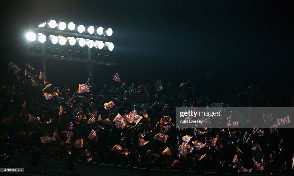 Supporters of FC Barcelona wave flags prior to the UEFA Champions League Round of 16 match between FC Barcelona and Manchester City at Camp Nou on March 12, 2014 in Barcelona, Spain.