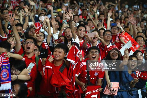 Supporters of FC Bayern Muenchen during a training session at Shenzhen Universiade Sports Centre during the Audi Summer Tour 2017 on July 21 2017 in...