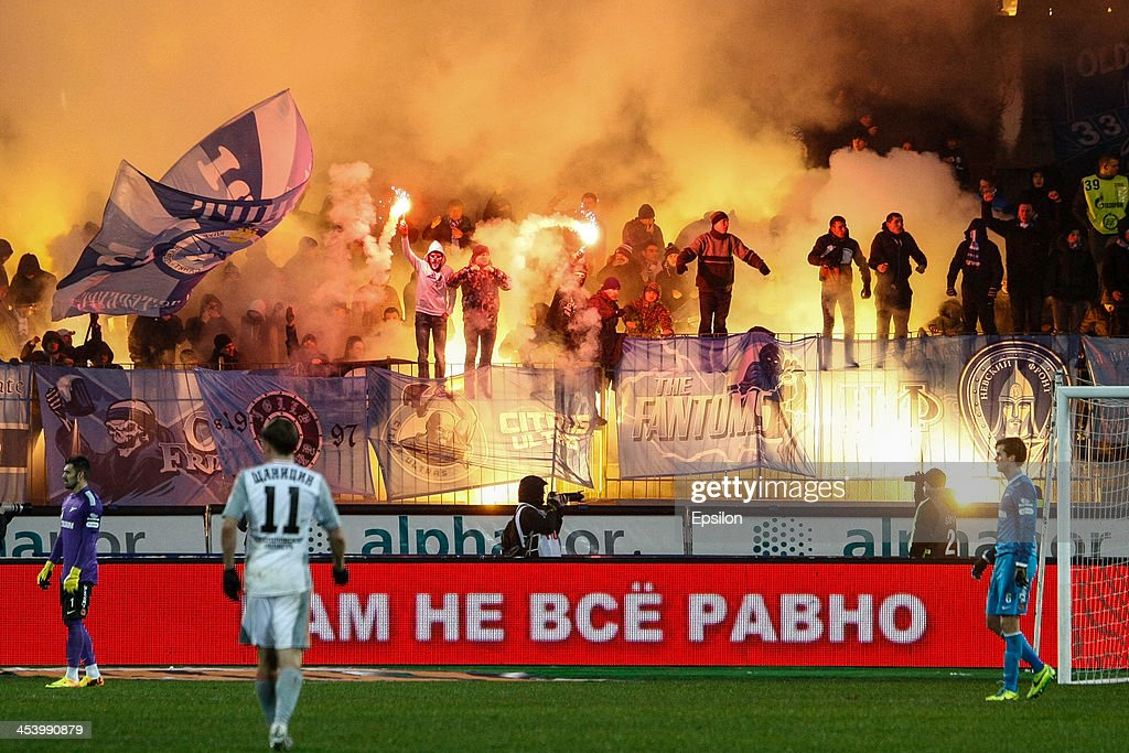 Supporters of FC Zenit St. Petersburg light flares during the Russian Football League Championship match between FC Zenit St. Petersburg and FC Ural Sverdlovsk Oblast at the Petrovsky stadium on December 6, 2013 in St. Petersburg, Russia.