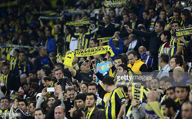 Supporters of Fenerbahce cheer the team during the Turkish Spor Toto Super League football match between Fenerbahce and Galatasaray at Sukru...
