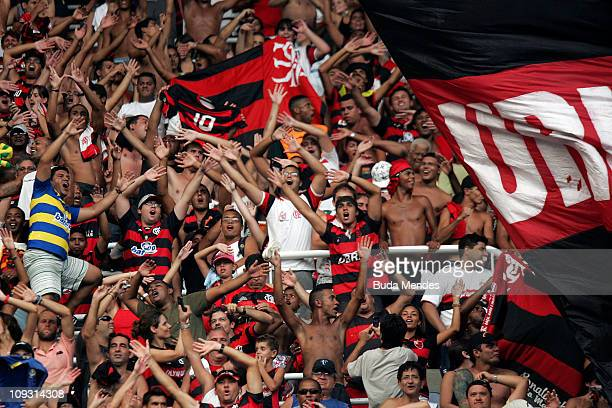 Supporters of Flamengo celebrate a victory over Botafogo at the semifinal of the Rio de Janeiro State Championship 2011 at Engenhao Stadium on...
