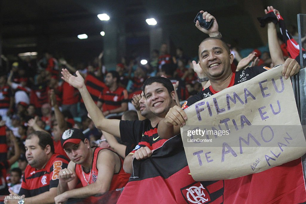 Supporters of Flamengo cheer for their team during a match between Flamengo and Bahia as part of the Brazilian Serie A Championship at Arena Fonte Nova Stadium on July 31, 2013 in Salvador, Brasil.