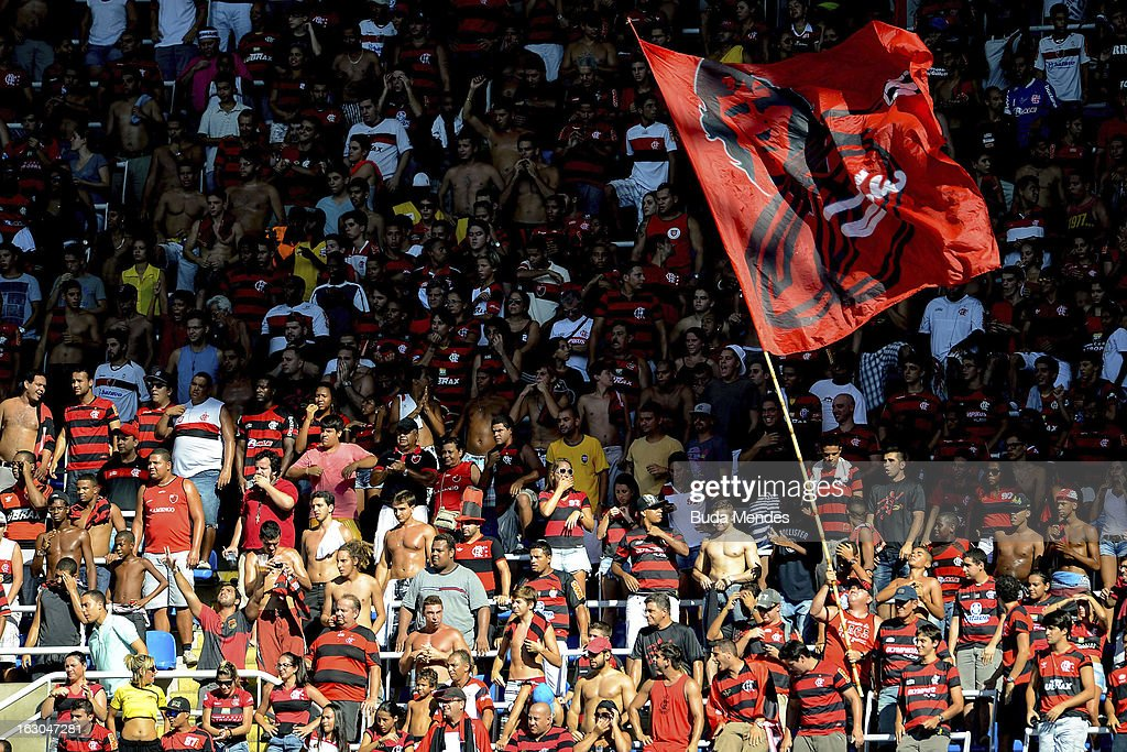 Supporters of Flamengo cheer for their team during the match between Botafogo and Flamengo as part of Carioca Championship 2013 at Engenhao Stadium on March 03, 2013 in Rio de Janeiro, Brazil.