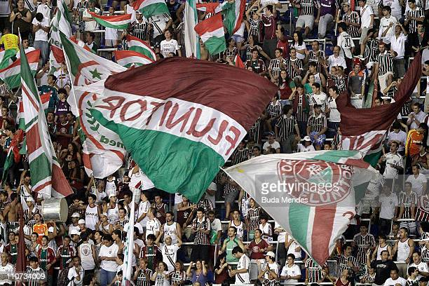 Supporters of Fluminense celebrate a scored goal against America MEX during a match as part of Libertadores Cup 2011 at Engenhao stadium on March 23...
