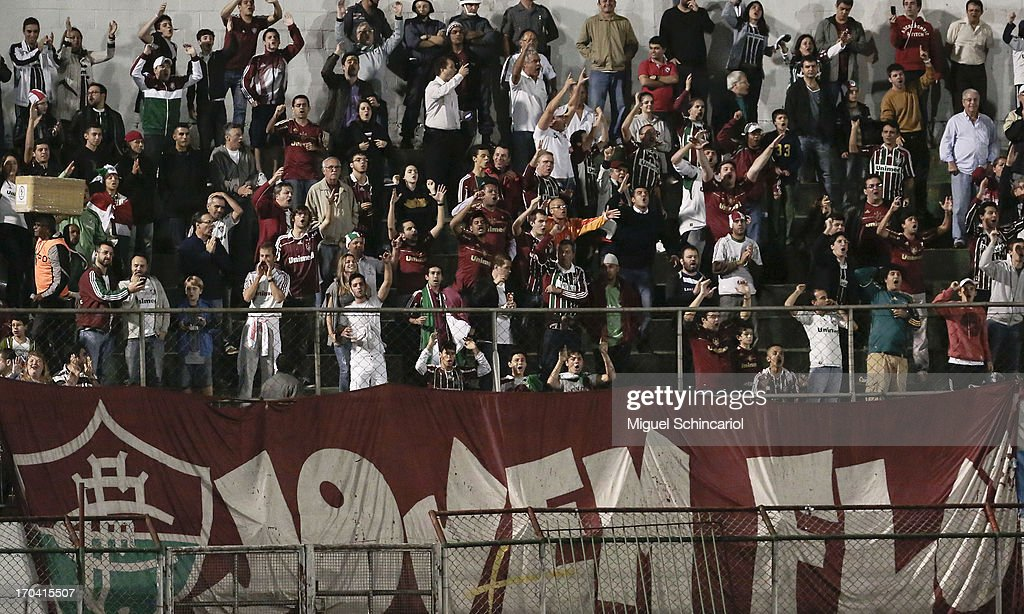 Supporters of Fluminense during a match between Portuguesa and Fluminense as part of the Brazilian Serie A 2013 at Caninde stadium on June 12, 2013 in Sao Paulo, Brazil