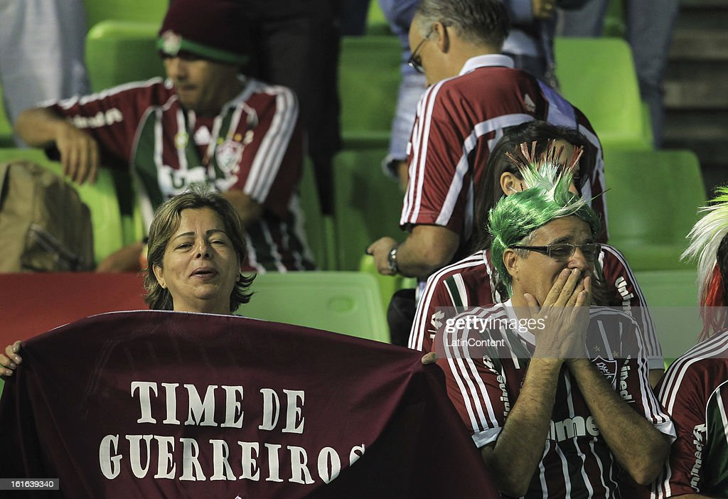 Supporters of Fluminense support their team during a game between Fluminense FC and Caracas as part of the Copa Bridgestone Libertadores 2013 at the Olympic Stadium on February 13, 2013 in Caracas, Venezuela.