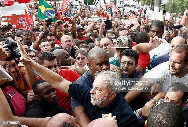 Supporters of former Brazilian president Luiz Inacio Lula da Silva surround him as he arrives at his flat in Sao Bernardo do Campo Sao Paulo Brazil...