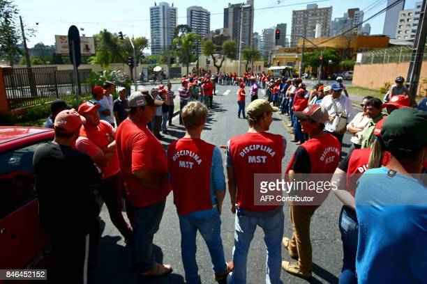 Supporters of former Brazilian President Luiz Inacio Lula da Silva wait for his arrival at tha Federal Justice office to be questioned by...