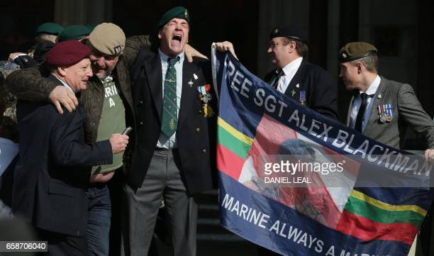 Supporters of former British soldier Alexander Blackman Marine A react outside the The Royal Courts of Justice in London on March 28 after learning...