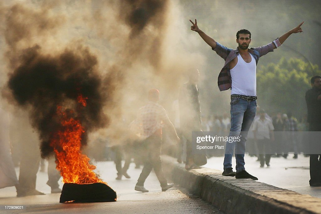 Supporters of former Egyptian President Mohammed Morsi burn tires along a bridge in protest over his removal by the Egyptian military on July 5 2013...