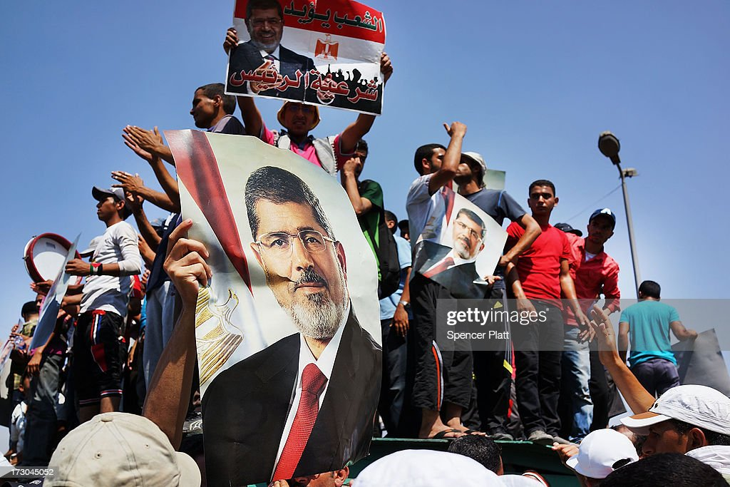 Supporters of former Egyptian President Mohammed Morsi march following Friday prayers in protest over his removal by the Egyptian military on July 5...