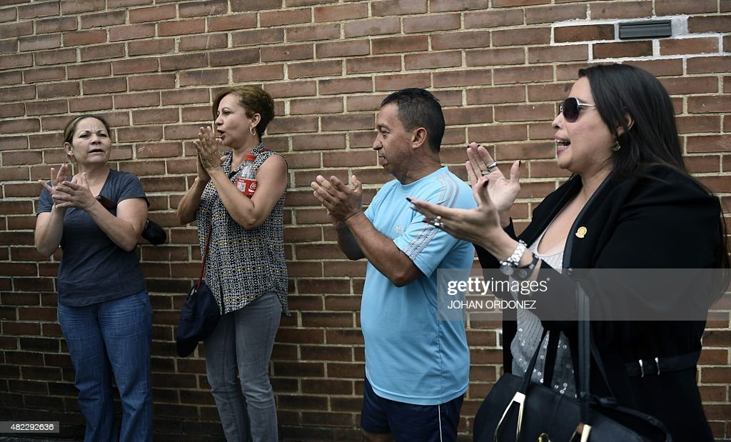 Supporters of former Guatemalan dictator Gen Jose Efrain Rios Montt celebrate after his lawyer got legal protection and stopped his transfer to the...