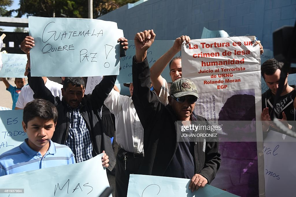 Supporters of former Guatemalan dictator retired General Jose Efrain Rios Montt demonstrate at the entrance of the Carlos Federico Mora Mental Health...
