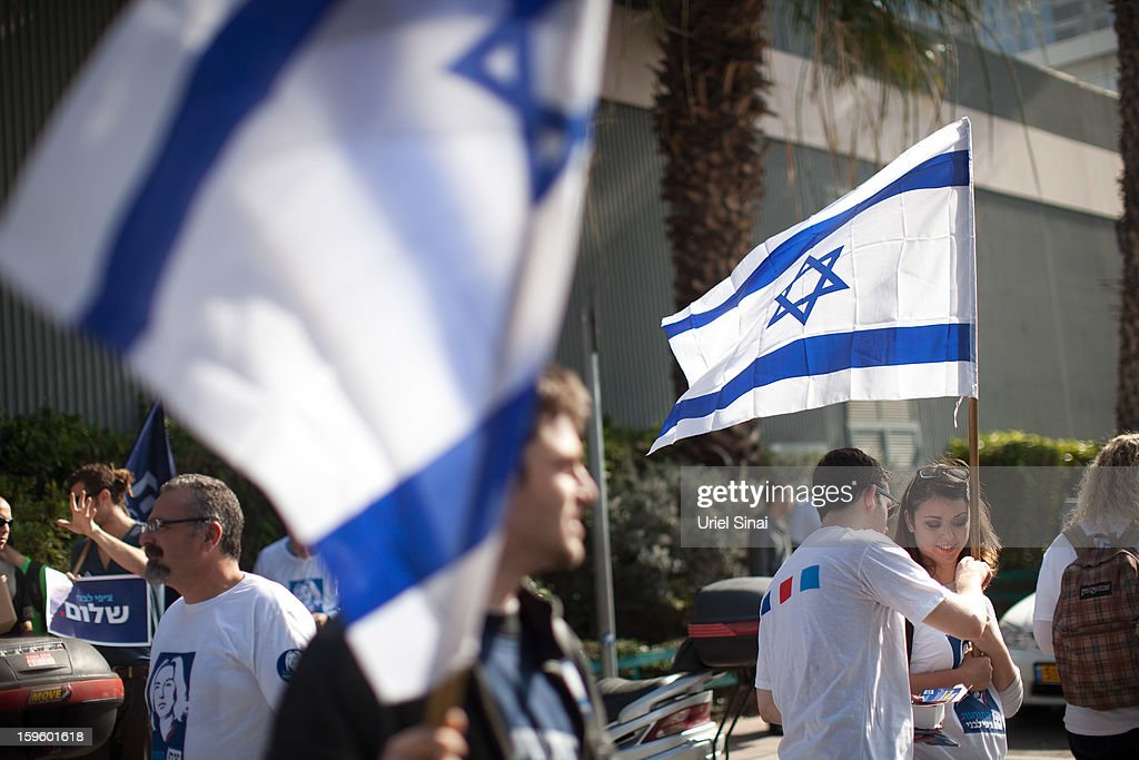 Supporters of former Israeli foreign minister Tzipi Livni, the leader of new party, The Movement, wave flags ahead of an election event at a shopping center on January 17, 2013 in Ramat Gan, Israel. Israel will go to the polls on January 22.