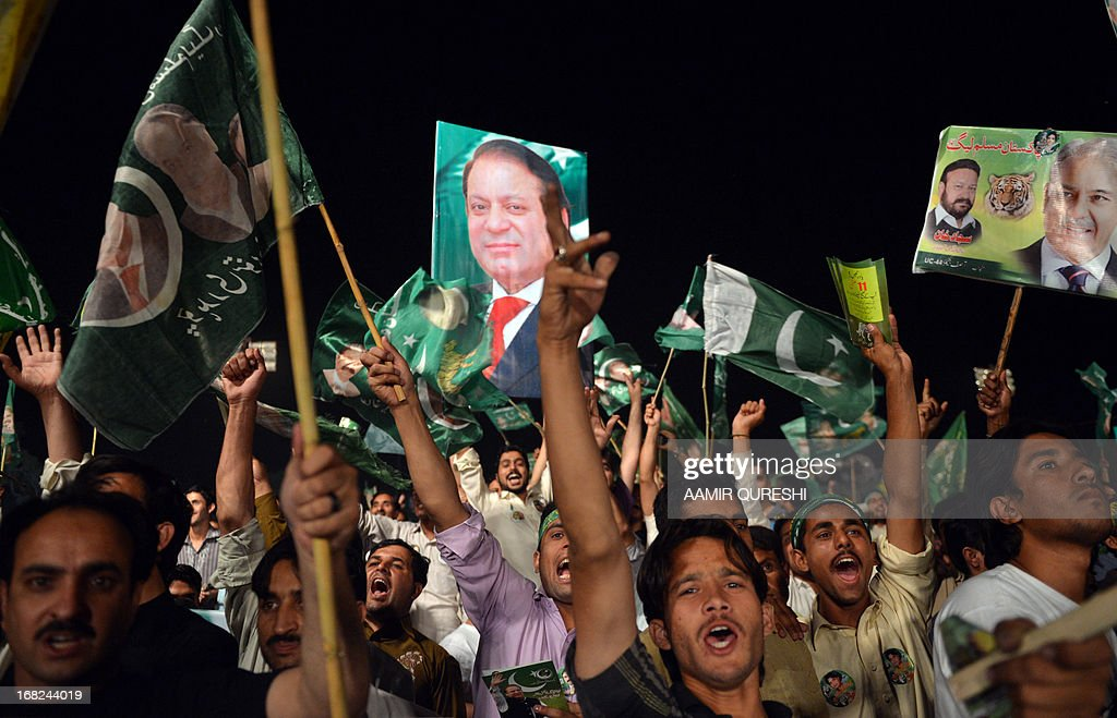 Supporters of former Pakistani Prime Minister Nawaz Sharif shout slogans in an election campaign meeting in Rawalpindi on May 7, 2013. The election will mark a democratic milestone in a country ruled for half its history by the military. It will be the first time that a civilian government has served a full term and handed over to another at the ballot box.
