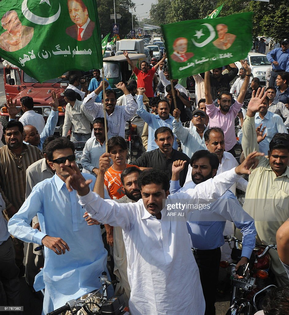 Supporters of former Pakistani prime minister Nawaz Sharif�s PML-N party march in Lahore October 12, 2009. The PML-N observes October 12 as a black day in commemoration of former president general Pervez Musharraf's coup against the PML-N government in 1999. Sharif was first elected prime minister in 1990 but was sacked three years later on corruption charges. He returned to power in 1997, but was ousted in the 1999 coup by Musharraf, who brought criminal charges against him for hijacking, terrorism and attempted murder. AFP PHOTO/ Arif ALI