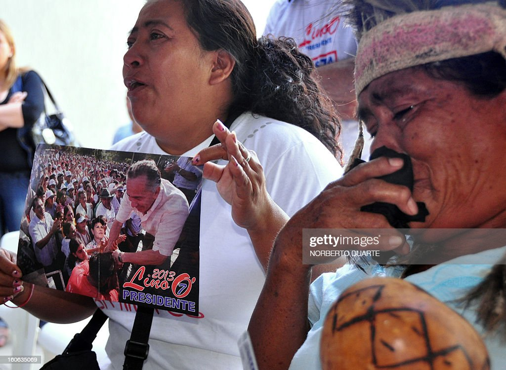 Supporters of former Paraguayan general and UNACE party presidential candidate Lino Oviedo --who died along with his bodyguard Denis Galeano and pilot Ramon Picco Delmas in a helicopter crash on February 2-- cry at the party's headquarters in Asuncion on February 4, 2013. Oviedo, 69, the controversial presidential candidate who helped topple Paraguayan dictator Alfredo Stroessner in 1989, died when the aircraft crashed en route to Asuncion while returning from a campaign rally in northern Paraguay, prompting claims of foul play. AFP PHOTO/Norberto DUARTE