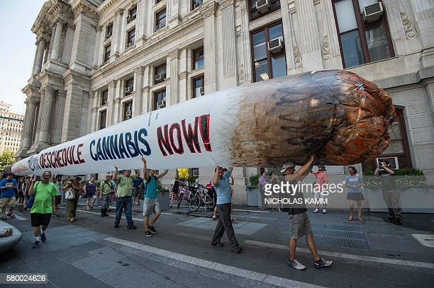 Supporters of former US Democratic presidential candidate Bernie Sanders hold a giant inflatable joint calling for the legalization of marijuana...