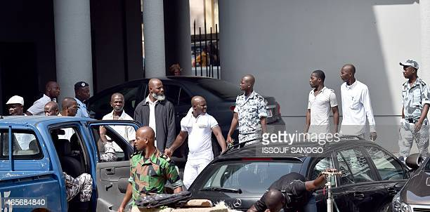 Supporters of Former Yvory Coast's president Laurent Gbagbo arrive at the Court of Justice in Abidjan on March 9 to attend a hearing of their trial...