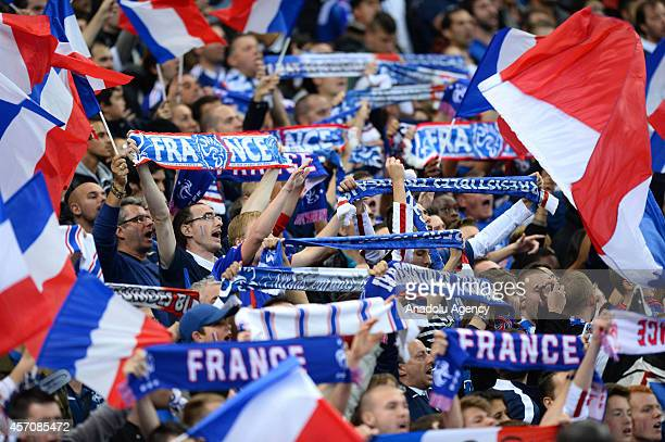 Supporters of France national soccer team cheer up during the international friendly soccer match between France and Portugal at Stade de France on...