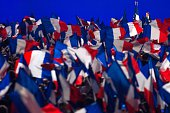 Supporters of France's incumbent president and Union for a Popular Movement candidate for 2012 presidential election Nicolas Sarkozy wave national...