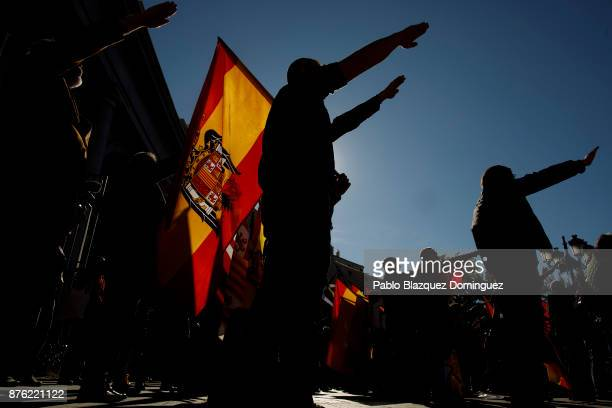 Supporters of Franco do a fascist salute as one holds a preconstitutional Spanish flag during a rally commemorating the 42nd anniversary of Spain's...
