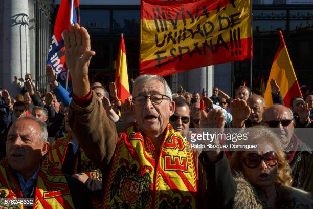 Supporters of Franco do fascist salutes as others hold a banner reading 'For the Unity of Spain' during a rally commemorating the 42nd anniversary of...