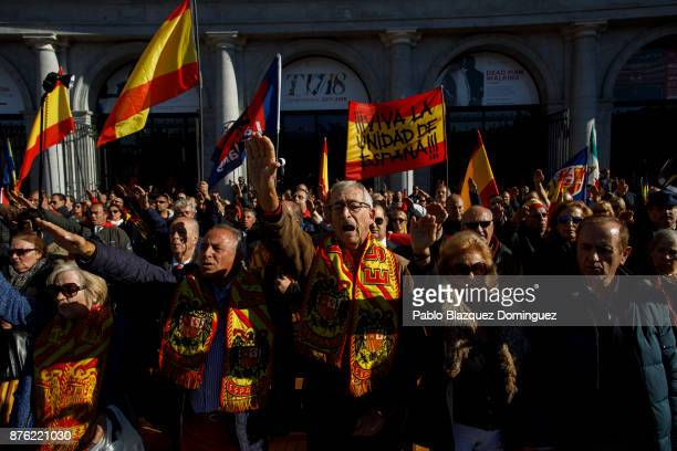 Supporters of Franco do fascist salutes wearing scarfs with a preconstitutional Spanish flag as some hold a banner reading 'For the Unity of Spain'...