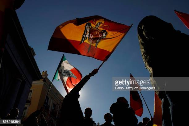 Supporters of Franco wave a preconstitutional Spanish flag and an Italian Social Republic flag during a rally commemorating the 42nd anniversary of...