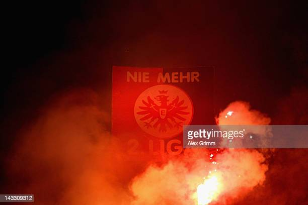 Supporters of Frankfurt burn flares during the Second Bundesliga match between Alemannia Aachen and Eintracht Frankfurt at Tivoli Stadium on April 23...
