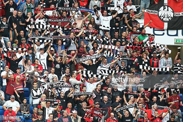 Supporters of Frankfurt celebrate during the Bundesliga match between 1899 Hoffenheim and Eintracht Frankfurt at RheinNeckarArena on September 1 2012...