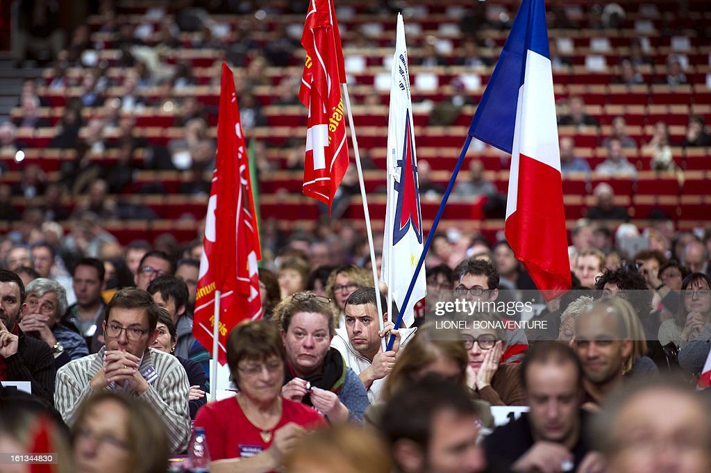 Supporters of French Communist Party (PCF) listen to PCF's national secretary delivering a speech on February 10, 2013, closing the 36th Congress of the French Communist Party in Saint-Denis, north of Paris. French Communist Party (PCF) national secretary Pierre Laurent, 55, the sole candidate to his own succession was re-elected with 100 percent of the 624 votes. AFP PHOTO / LIONEL BONAVENTURE