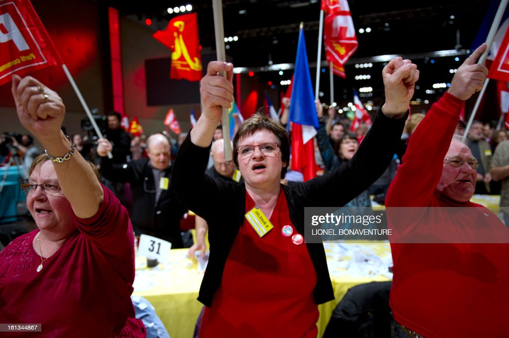Supporters of French Communist Party (PCF) sing the revolutionary workers anthem the International on February 10, 2013, at the end of the 36th Congress of the French Communist Party in Saint-Denis, north of Paris. French Communist Party (PCF) national secretary Pierre Laurent, 55, the sole candidate to his own succession was re-elected with 100 percent of the 624 votes. AFP PHOTO / LIONEL BONAVENTURE