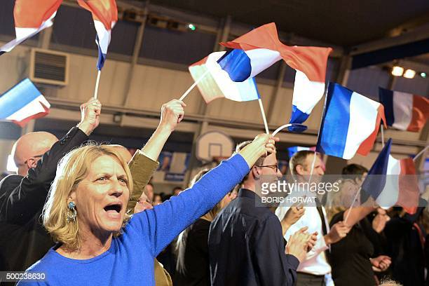 Supporters of French far right Front National party's Parliament member and candidate for the regional elections in the ProvenceAlpesCote d'Azur...