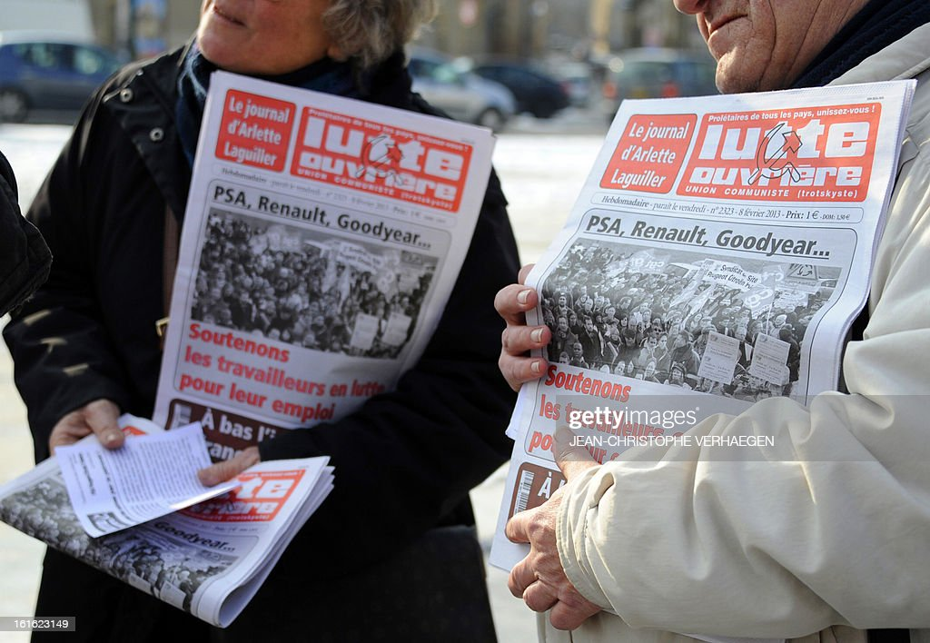 Supporters of French far-left Lutte Ouvriere (Workers' Struggle) party sell their militant newspapers on February 13, 2013 in Metz, eastern France, prior to a demonstration called by French CGT trade union, to claim for the safeguard of the local industry in the French eastern region of Lorraine.