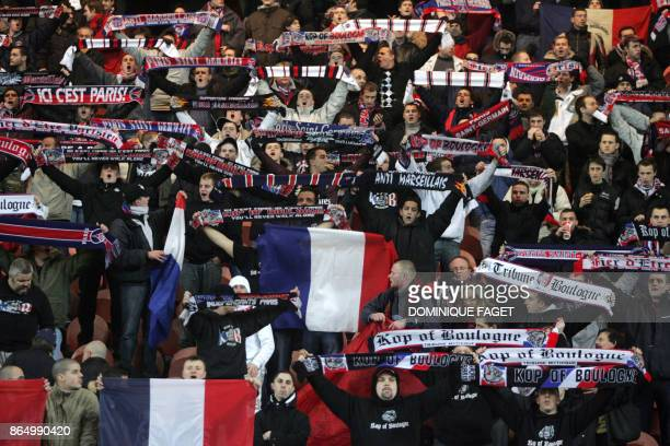 Supporters of French L1 football club ParisSaintGermain hold banners of their group called 'Kop of Boulogne' in the Boulogne stands during the...