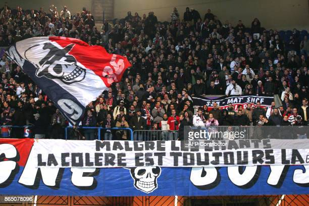 Supporters of French L1 football club ParisSaintGermain hold banners in the Boulogne stands 27 January 2007 at Le Parc des Princes stadium in Paris...