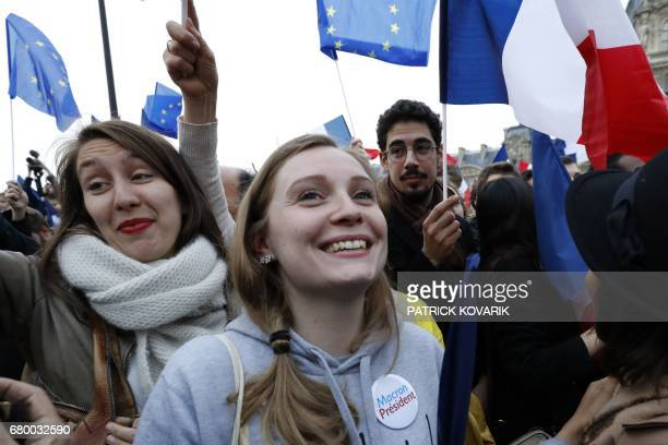 Supporters of French presidential election candidate for the En Marche movement Emmanuel Macron celebrate in front of the Pyramid at the Louvre...