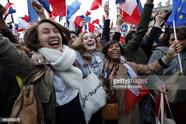 TOPSHOT Supporters of French presidential election candidate for the En Marche movement Emmanuel Macron celebrate in front of the Pyramid at the...