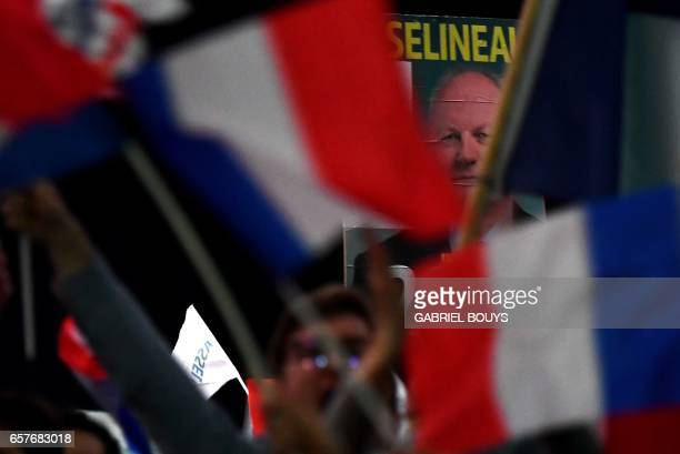 Supporters of French presidential election candidate for the Popular Republican Union party wave campaign flags and French national flags during a...