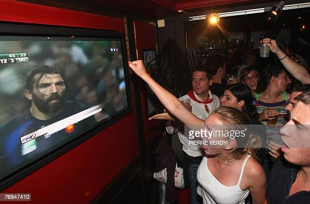 Supporters of French rugby union team reacts as they watch France's lock Sebastien Chabal on a giant TV screen during their World Cup group D match...