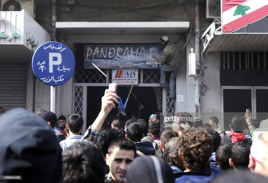 Supporters of Future Movement attack Lebanese MP Mohammed al-Safadi offices during a demonstration in support of caretaker prime minister Saad Hariri in the Sunni bastion coastal city of Tripoli north of Beirut on January 25, 2011.