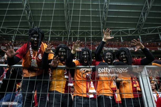 Supporters of Galatasaray with make ups photo for a photo during the Turkish Super Lig match between Galatasaray and Fenerbahce at Ali Sami Yen...