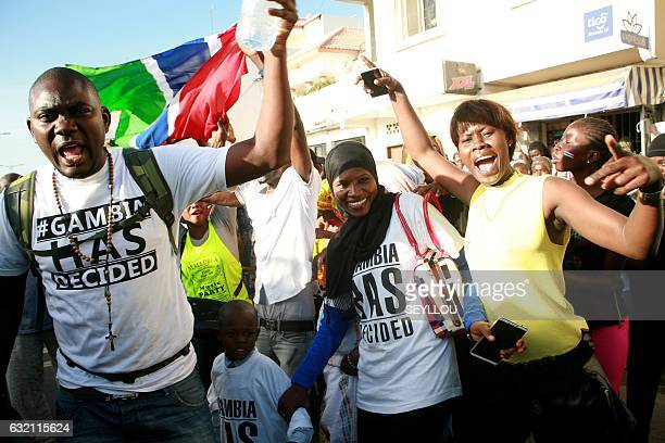 Supporters of Gambia's Presidentelect Adama Barrow celebrate outside of the Gambian Embassy in Dakar on January 19 2017 Gambia's new president Adama...
