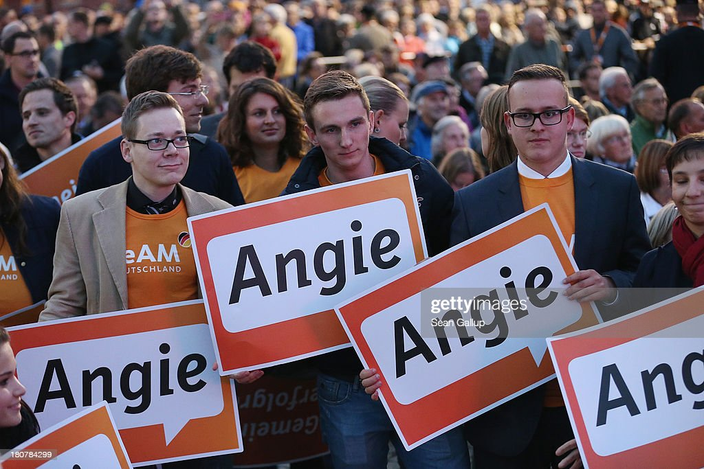 Supporters of German Chancellor and Chairwoman of the German Christian Democrats (CDU) Angela Merkel attend a CDU election rally at which Merkel spoke on September 16, 2013 in Potsdam, Germany. Germany faces federal elections on September 22 and so far the CDU has a strong lead in polls over the opposition.