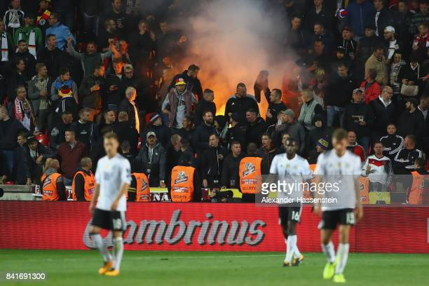 Supporters of Germany burns firewoks during the FIFA World Cup Russia 2018 Group C Qualifier between Czech Republic and Germany at Eden Arena on...