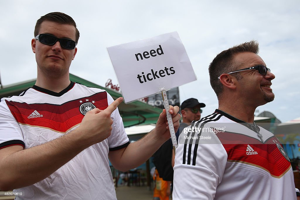 Supporters of Germany search for match tickets alongside Copacabana Beach ahead of the 2014 FIFA World Cup Brazil Final match on July 12, 2014 in Rio de Janeiro, Brazil.