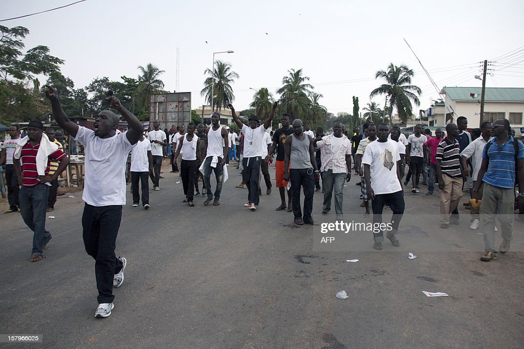 Supporters of Ghana's opposition New Patriotic Party chant slogans at a protest over alleged vote-rigging on December 8 2012 in Accra.Ghanaian authorities fired tear gas on Saturday to disperse a crowd of more than 100 people in the capital Accra who were angry over rumours of rigging in the country's elections.