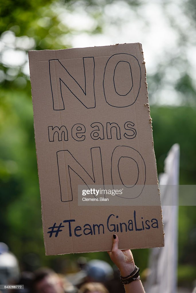 Supporters of <a gi-track='captionPersonalityLinkClicked' href=/galleries/search?phrase=Gina-Lisa+Lohfink&family=editorial&specificpeople=5531729 ng-click='$event.stopPropagation()'>Gina-Lisa Lohfink</a> stand in front of the court house during a trial on June 27, 2016 in Berlin, Germany.